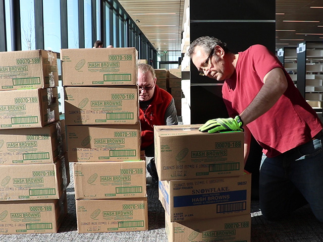 Around 20 employees helped pack and unpack roughly 40,000 books.