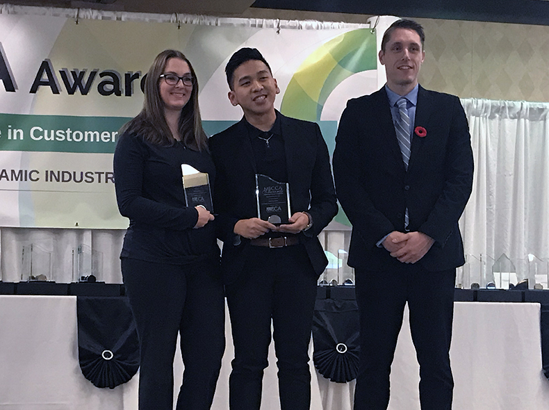Monica Noakes (left) and Lawrence Castro (centre) from the Water and Waste Department's Utility Billing Centre receive their awards.