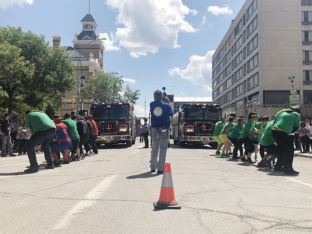 The Fire Engine Pull serves as the annual City of Winnipeg Charitable Fund campaign kickoff.