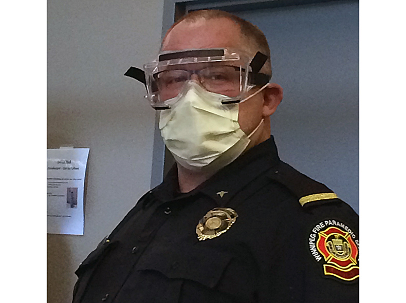 A Paramedic Training Officer with a mask and safety glasses