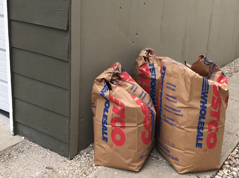 Residents should not store their yard waste next to any buildings or fences.