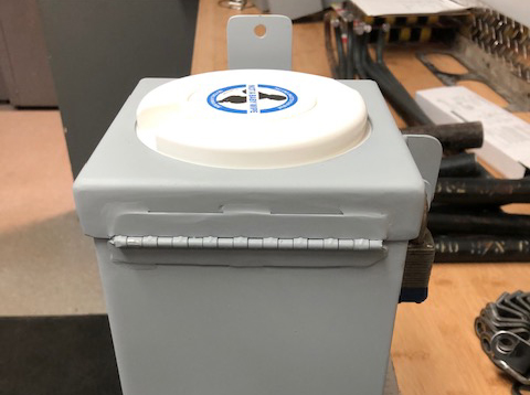 A lock box for disposable wipes custom designed by Winnipeg's Fleet Management Agency