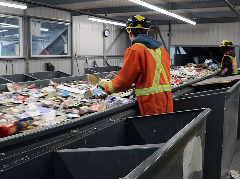 Some manual sorting is required to separate items not sorted by machines and materials that aren't accepted.
