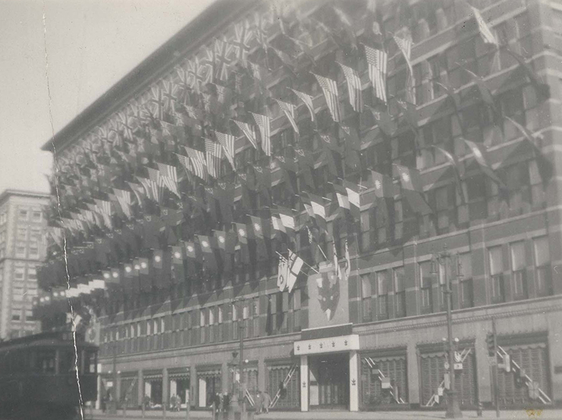 The former Eaton's building on Portage Avenue decorated with flags to celebrate VE Day.