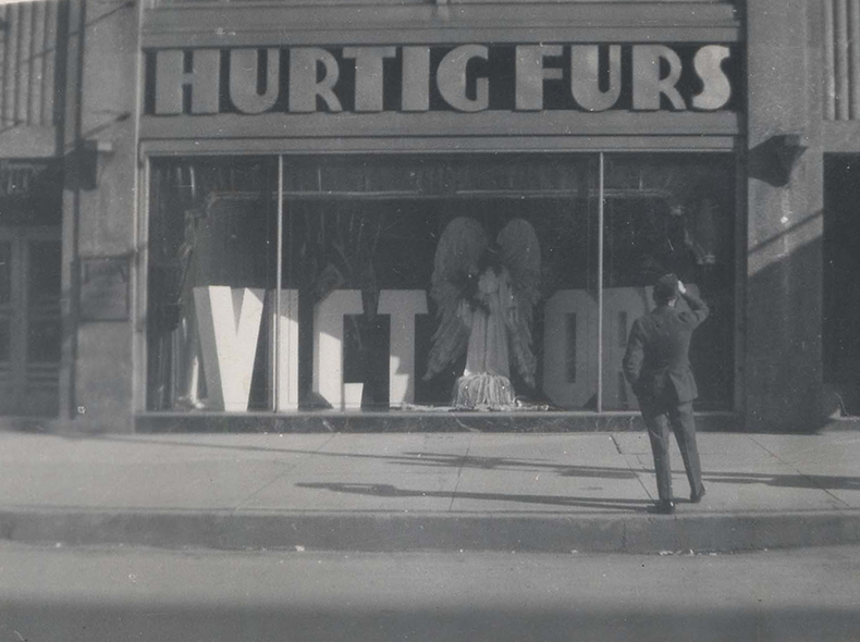 A street view of Hurtig Furs, formerly at 262 Portage Avenue, prominently shows a victory sign in the display window.