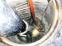 View down sewer as cleaning progresses